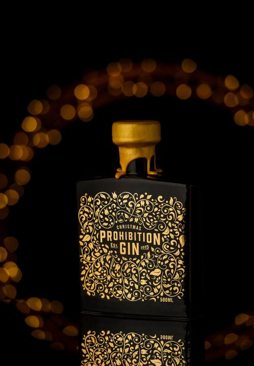 Prohibition Liquor Co Christmas Gin on dark background with out of focus fairy lights